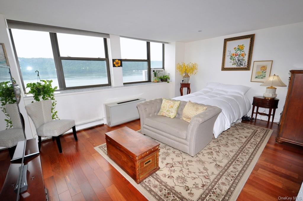 Sleeping Area has Hudson River and Palisades views and is large enough for plenty of furniture.  There is a frosted glass wall with French glass panel doors dividing the living area from the sleeping area.