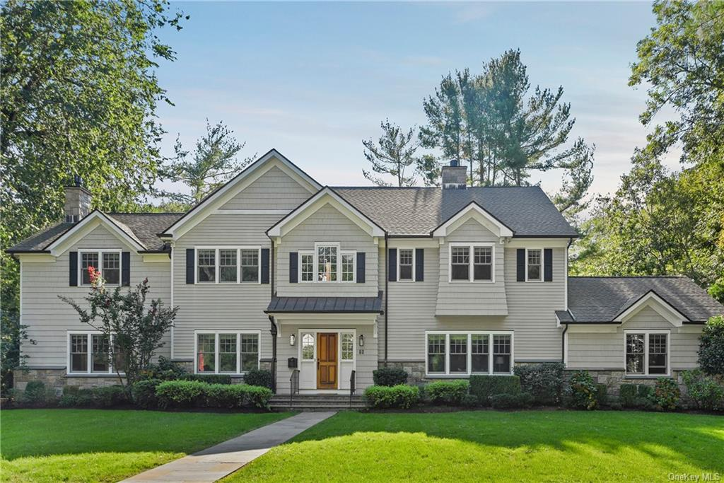 Beautiful 2004 young Colonial in the heart of Fox Meadow. This home sits on .32 acres with 5 bedrooms and 5 1/2 baths. Only a few minutes walk to Scarsdale High School, Library and Fox Meadow Elementary School. Also a 12 minute walk to both Scarsdale and Hartsdale Villages and trains. Move right in- updated in 2019! This home has it all: living room with fireplace, formal dining room, large eat-in kitchen with center island and breakfast area, family room/gas fireplace off the kitchen, first floor bedroom with bathroom, mudroom  and 2 car garage. Second floor: Master bedroom suite with large office, 2 walk-in closets and large ultimate master bathroom. Plus 2 bedrooms that share a bathroom and bedroom with hall bathroom. Second floor laundry room. Amazing lower level- not to be missed. Family room with bar area, recreation room, full bathroom and plenty of storage. 4 zones Hydro Air-HVAC,  9 foot ceilings on first and second floors and much more. Amazing location, space and condition.