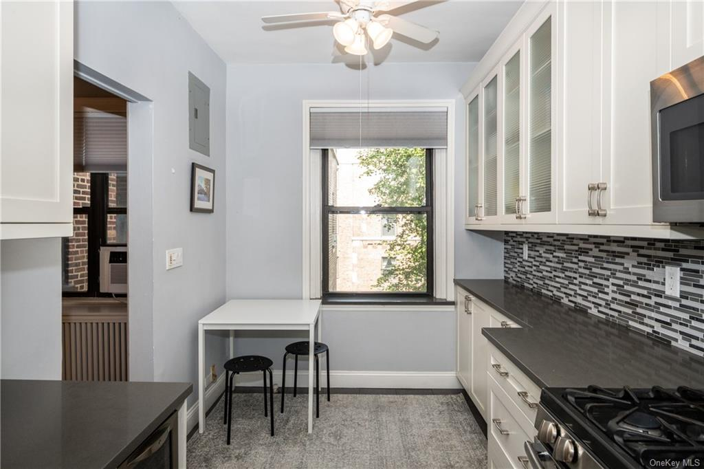 Windowed kitchen with dining area