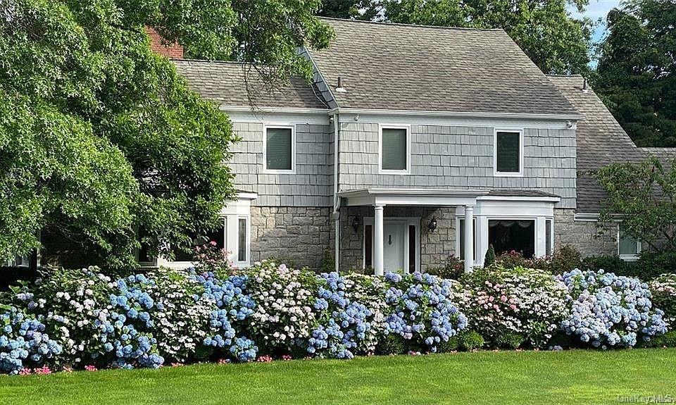 Grand center hall colonial with 6 bedrooms, 7 bathroom and 2 half baths in most desirable location in Hewlett Bay Park! This spacious home features a huge eat in kitchen as well as a sunny breakfast room, large formal dining room, living room, office, gym & family room. Full finished basement with bedroom & bathroom. Resort-like property just shy of an acre, with gunite heated in-ground pool & cabana with kitchen/bathroom/changing room attached to house. Hardwood floors throughout. All systems. Sd#14. 40 min to NYC.. Assessed tax value to be reduced by 50 percent