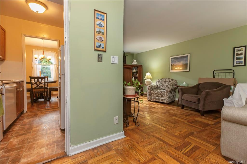 Rare opportunity at Grey Oaks. This cozy one bedroom boasts hardwood parquet floors throughout, abundant storage, newer kitchen appliances, a BONUS room that is suitable for a home office/dining room/ or spare bedroom. LOW MAINTENANCE of $577 per month before STAR. Enjoy peace and quiet on the northwestern side of the building, a community pool included in the maintenance, and a parking space that is ASSIGNED to the apartment! Located close to commuter highways and walking distance to all your shopping needs, this will not last in todays market!