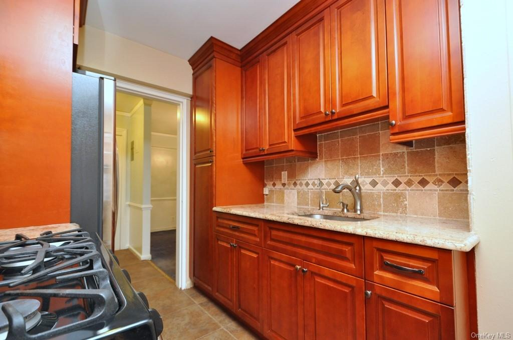 New Kitchen with Granite counters, cherry cabinets and stainless steel appliances.