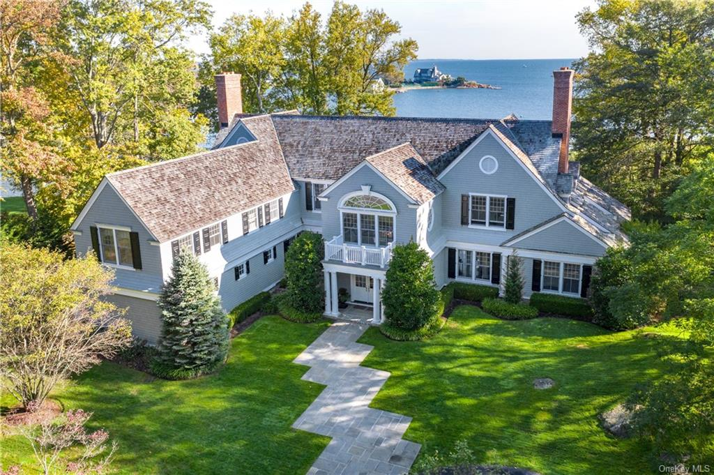Exquisite waterfront custom Colonial with private shoreline & breathtaking panoramic views of Long Island Sound from every vantage point and room. Designed by renowned architects Shope, Reno & Wharton, this is one of Rye   s finest and most exclusive waterfront properties. Elevated, protected & privately positioned, it offers the ultimate luxury lifestyle. A masterpiece of craftsmanship, this 7,490 sq ft, 5-bed home is light-filled & graced by soaring ceilings & walls of windows (add'l 1,008 sq ft on 3rd level not incl in above sq ft) From the grand 2-story foyer, to the formal living & dining rooms & rich walnut-paneled wet bar   glistening waterfront views abound. The open-plan kitchen is spectacular, and the serenity of a family meal waterside is incomparable. Complemented by a glorious sunroom, 5 fireplaces, hardwood fls, and a lavish master suite, this is resort-like living.  Dock permitting in progress. Multiple pool site options with one virtual image shown.  35mins from NYC.
