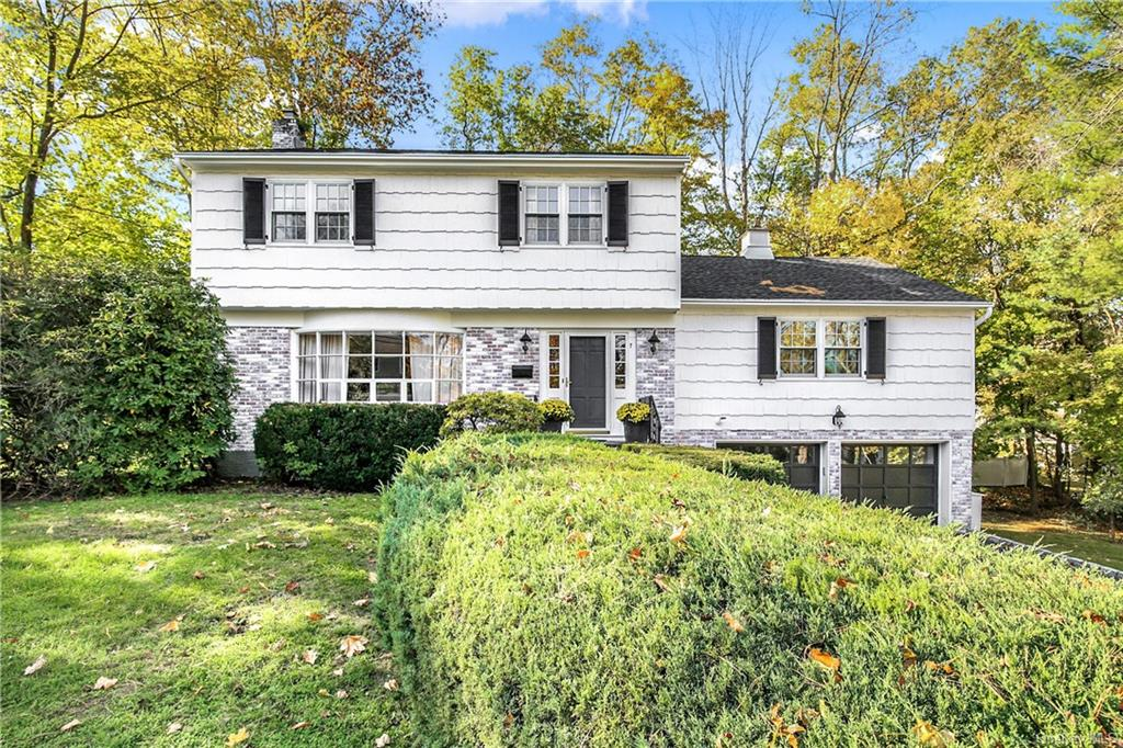 Curb appeal and move in ready, this meticulously maintained and renovated Colonial with park-like property on a tranquil street in the Quaker Ridge section of Scarsdale with free district bus to Elementary & High School, is a special find for today's buyer.  This home has been thoughtfully renovated and includes 3-4 (one being the perfect home office or guest room) light filled bedrooms, two and two-   renovated bathrooms, a renovated kitchen with stainless high-end appliances, easy access to an oversized deck for outdoor alfresco dining and entertaining and plenty of space for outdoor play. The stunning, spacious family room is the perfect spot to relax and unwind. The expansive lower level features a play area, exercise area, laundry,    bath, ample storage closets and utilities. Please note that the square footage includes the finished lower level. The hot tub is in AS-IS condition. Hardwood floors throughout. Two car attached garage. Please follow COVID protocols. This home is a gem!