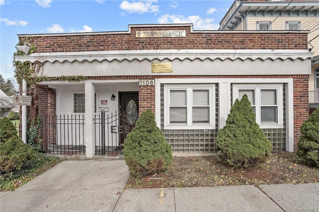 Stand alone, single tenant, single story building with front and back entrances located in the heart of town, half a block from municipal parking. Generous .36 Acre of fenced-in lawn and private parking. Convenient location. On bus route. Walk to restaurants and shopping.