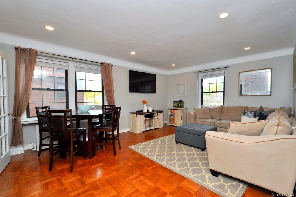 Large Living Room can accommodate both living and dining area leaving the dining room to be used as a home office / den / guest room.  The living room has recessed lighting, picture molding and refinished parquet floors.  The living room is 19'-0