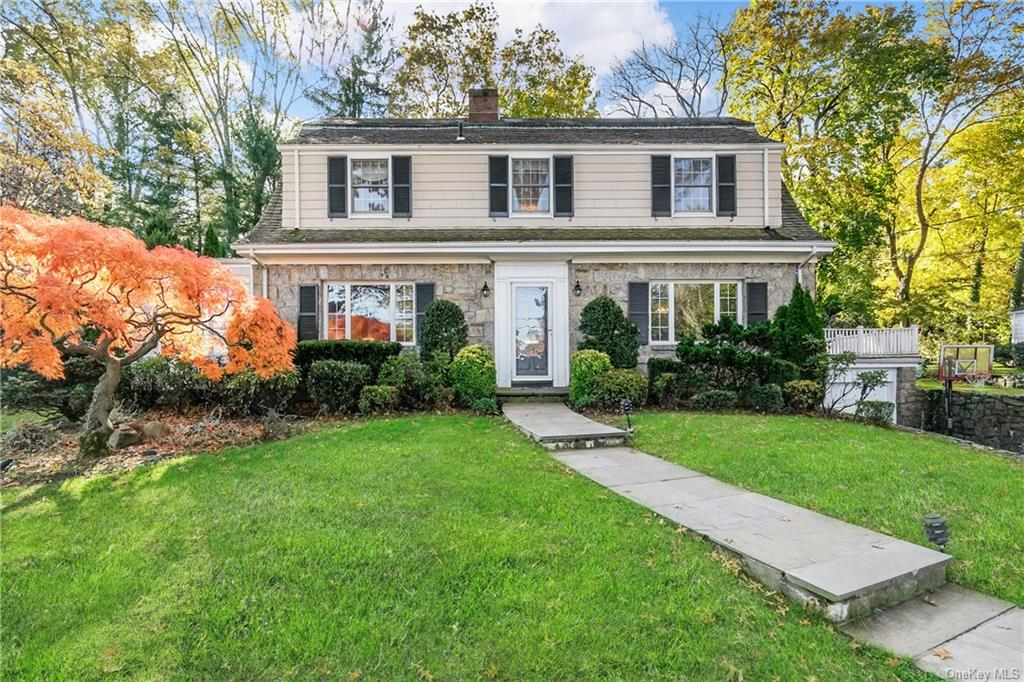 Sunlight streams into every room of this stately Quaker Ridge Colonial. The living room has a wood burning fireplace and built-in bookcase. Step into the family room with built in desk and direct access to bluestone patio and large, level private yard. Bask in the sun-filled dining room. Enjoy cooking in the spacious renovated kitchen with a large island. An office/bedroom with full bath enhance the first floor. Relax in the master suite with sumptuous bathroom and walk-in closet. Two additional bedrooms with a gorgeous hall bath make for an ideal modern layout. The spectacular lower level is a homeowner's dream, including built-in shelves, a separate laundry room and ample storage. Move right into this warm and inviting home!