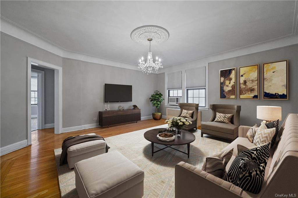 This unique shape of this living room (six sides)  allows for several configurations and seating arrangements.    This virtual staging is just one idea for this 2 Bedroom Co-op in Bronxville.