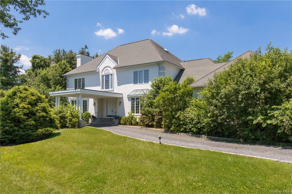 Exceptional Stately Center Hall Colonial on 0.95 acre in sought after Quaker Ridge estate area in Scarsdale. Nestled on a private setting this perfectly flat property features beautifully landscaped grounds and a stunning pool. The perfect layout showcases a grand two story entrance hall with marble floors and a curved staircase, grand formal rooms, a generous eat in kitchen with breakfast room and glass doors to the property and pool, an adjoining large family room with fireplace, formal library, first floor bedroom with bath, laundry and mud room and a 3 car attached garage on first level adjoining the mudroom.On the second level there are 4 additional expansive family bedrooms including a luxurious master suite with tray ceilings, fireplace, dressing area, marble bath with jacuzzi, separate shower & two vanities and his & hers walk in closets. Lower level features 1,122 finished square feet including a large recreation room, full bath and separate gymnasium. Exceptionally flat land.