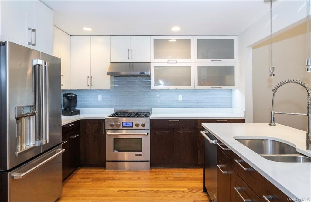 Beautiful custom made kitchen, Jenn Air appliances, Brand New (1 month old) GE Cafe Refrigerator.