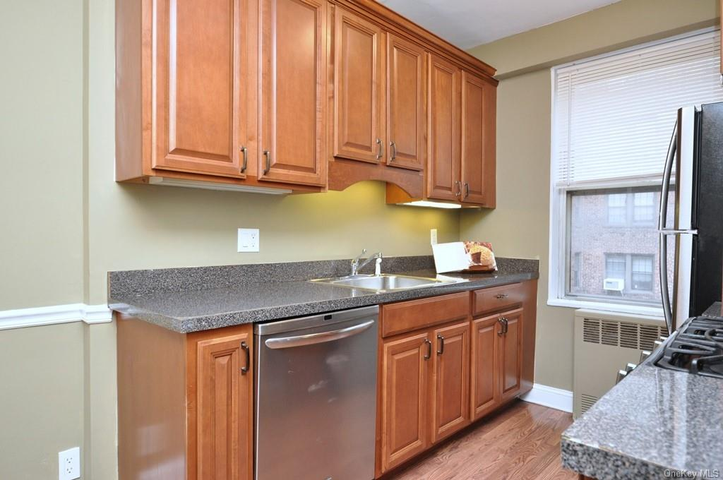 Renovated Eat-in-Kitchen with cherry cabinets with soft shut draws and roll out shelves.  Stainless Steal appliances include a dishwasher, range, microwave and refrigerator.  The eat-in-kitchen is 15'-3