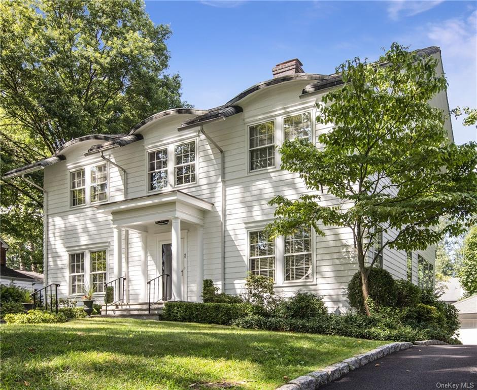 Ideally located in Edgewood, one of Scarsdale   s most sought after neighborhoods, this renovated five-bedroom Colonial home is picture perfect! High ceilings, classic symmetry with clean lines, restored doors, an open floor plan, and an abundance of light flowing through multiple exposures. The first floor entry opens to a gracious living room with a FPL flanked on either side by French doors. The elegant dining room is seamlessly connected to the beautiful new white kitchen with Quartz countertops. The family room features double exposure, with direct access to the living room. A unique master suite is comprised of the bedroom, dressing room/home office (or fifth bedroom) and Water Works master bath. A beautiful, level and private backyard with a large flagstone patio for entertaining and ample space for al fresco dining. The lower level provides an extra finished 500 sqft of versatile space. Close to Edgewood Elementary school, park, Scarsdale village, local bus and commuter train.