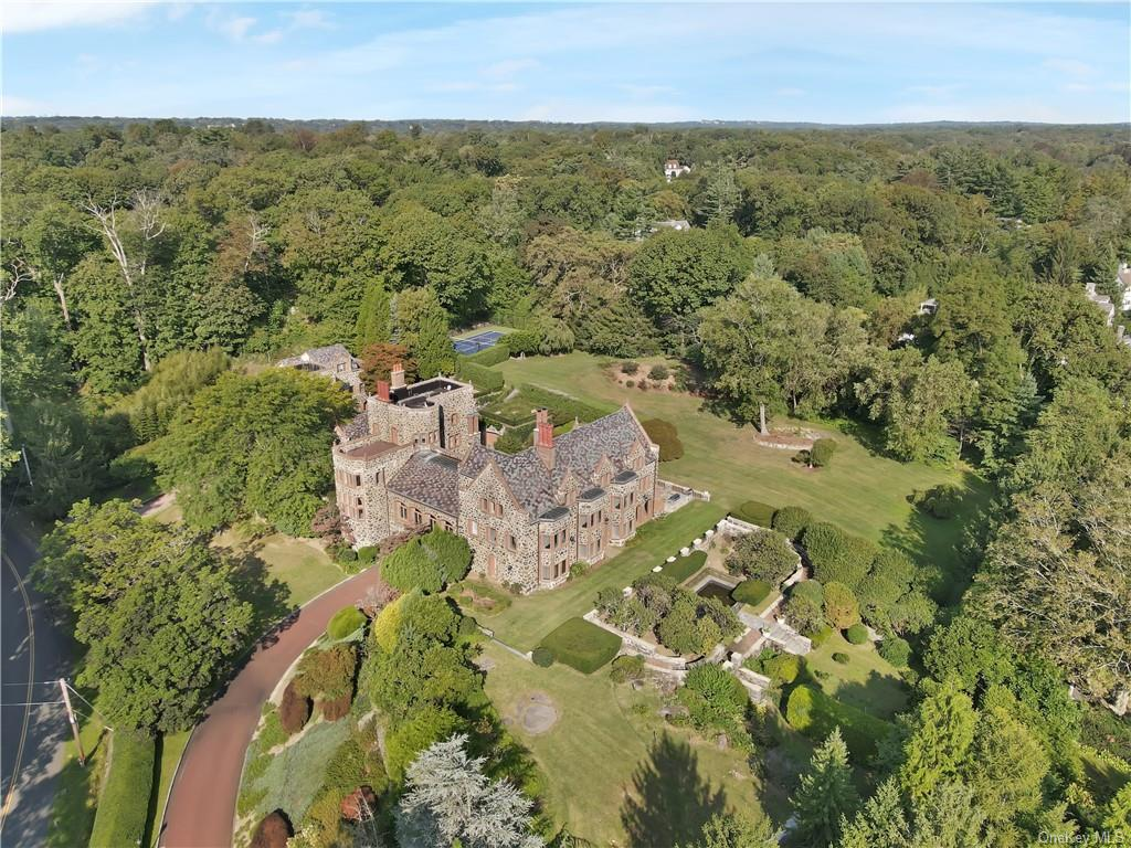 Unique opportunity to acquire    Freestone Castle   , originally built in 1913 by famed architect James C. Green.     Hemlock Castle    as it has come to be known is a stone, brick and slate masterpiece renovated and updated for today   s lifestyle, all the while incorporating period details.  20,298 sq.ft. includes the 13,500 sq.ft. 8 bedroom main residence and 2  +/- 3,400 sq.ft, 3-4 bedroom staff quarters/apartment/carriage house.   Incredible flexibility for multigenerational living, offices or advantageous HO which allowed for the condominiumization of up to 4 units. Situated on 4.18 acres of balustraded terraces overlooking reflecting pool, formal gardens, broad lawns and mature trees in Edgewood Park, minutes from downtown Greenwich.  Garages for 5 cars, carport and tennis court complete this true English Country Estate.