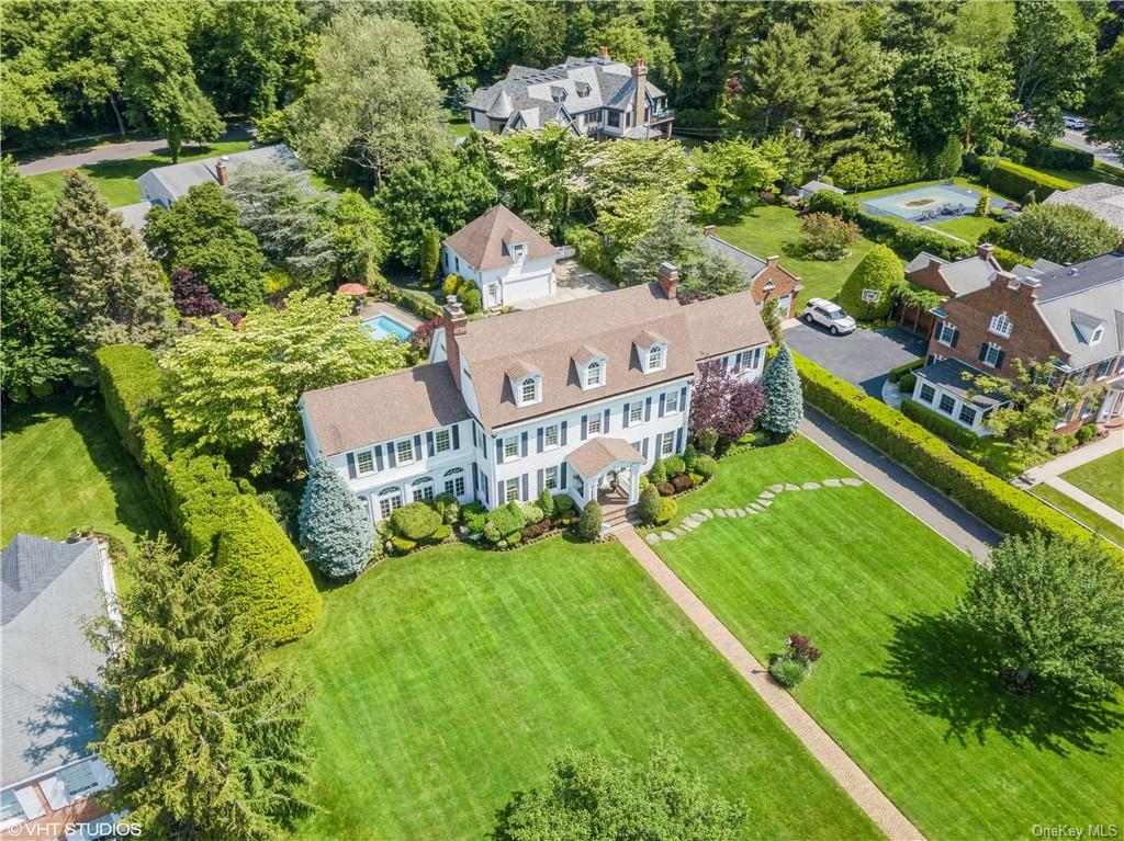 """Impeccably maintained 89 Tenth St. is a true iconic & historical Garden City home.This turn of the century masterpiece colonial offers beauty,elegance,detail,space & privacy.Ideally perched on """"THE HILL"""",southern views overlook the world renowned Garden City Golf Course.It is only 40 minutes from NYC & just a short walk to the center of Garden City's beautiful & vibrant village,w/unlimited dining, shopping & entertainment options.The backyard boasts a ctry club like 20' x 40' heated pool & sprinkler sys.The kitchen is complete with a 6 burner stove,2 sinks as well as a butler's pantry w/ its own sink, DW & ice maker.The grand winding staircase in the great hall rises to & encircles the 2nd & 3rd fl. landings. All rooms possess grand sizes,high ceilings,excessive sunlight,magnificent finishes & fine detail. There are 5 fireplaces throughout as well and with a whole house generator, 3 zone AC, 4 zone heating,alarm system & surround sound this home has it all. It is truly a village gem!!!"""