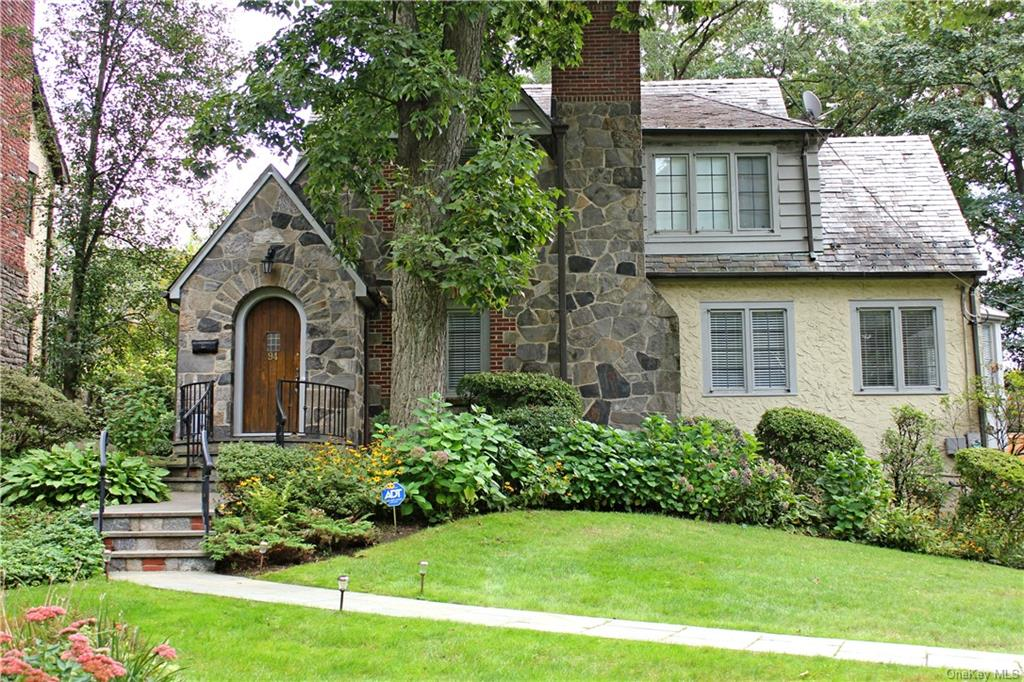 Your elegant stone Tudor in the coveted Manor Woods neighborhood awaits. Located only 10 minutes away from the Hartsdale Metro North Station and all of the quaint and charming shops and restaurants that Hartsdale has to offer.