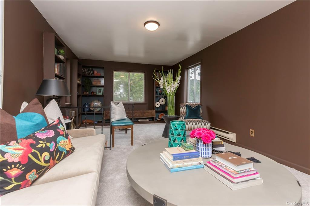 As seen on the HGTV series One Week To Sell, this home has been carefully designed by celebrity interior designer Taylor Spellman. Open concept floor plan and a cozy space to call home. This home features an expansive kitchen area with stainless steel appliances, a large outdoor seating area on the deck, carefully designed built in storage throughout to make the best use of the space, an unfinished basement for additional storage, and a three car detached garage for car lovers. This home will not last.
