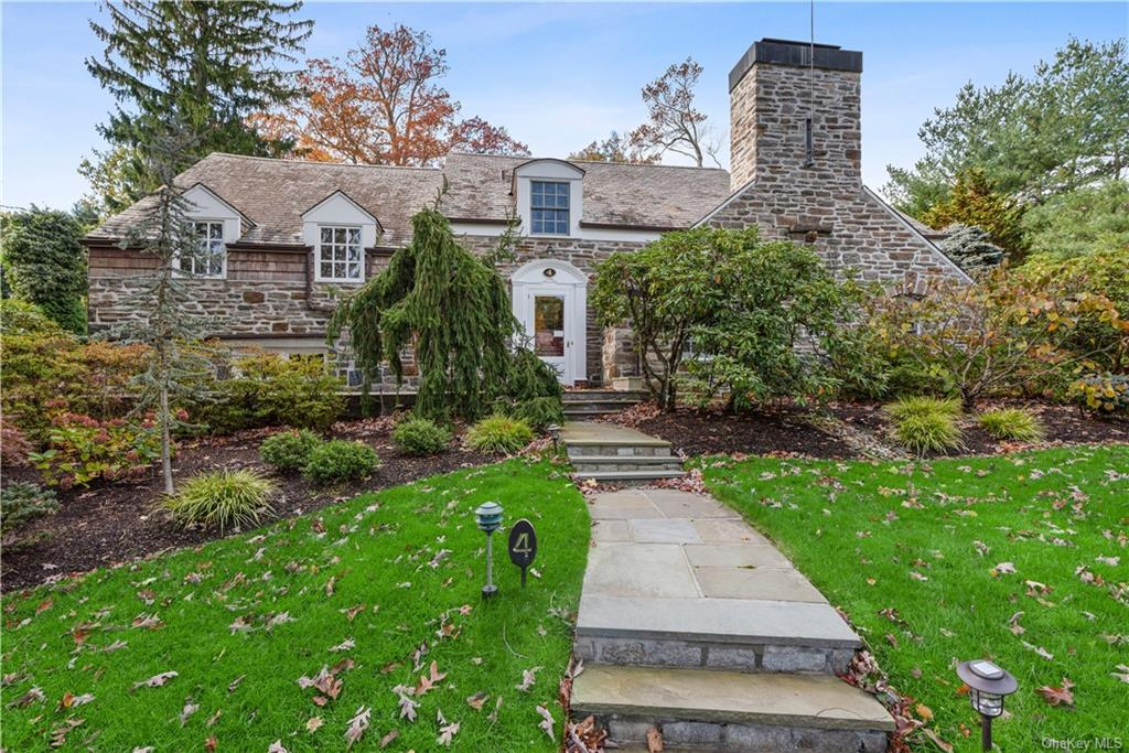 Private & tranquil, this elegant & unassuming home w/ room for a pool is located in the Quaker Ridge area of Scarsdale & just a short walk to elementary school.  Upon entry, one finds a magnificent sunken living room w/ beautiful architectural details, rich wood floors & fireplace.  A doorway takes you to a wood paneled den w/ fireplace, wet bar & French doors that lead to the private backyard.  The home has a spacious dining room replete w/ natural light & another view of the impressive backyard.  The spacious eat in kitchen has a built-in desk, commercial refrigerator, 6 burner stove & plenty of storage.  Completing the 1st floor is a generously sized bedroom w/ en suite bath.  The large primary bedroom suite has a separate dressing area & bath.  The 2nd floor offers plenty of closets, 3 add'l bedrooms & a hall bath.  The 3rd floor bedroom w/ en-suite could be the perfect home office.  The lower level includes a den w/ additional fireplace & recreation space.  Truly a must see!