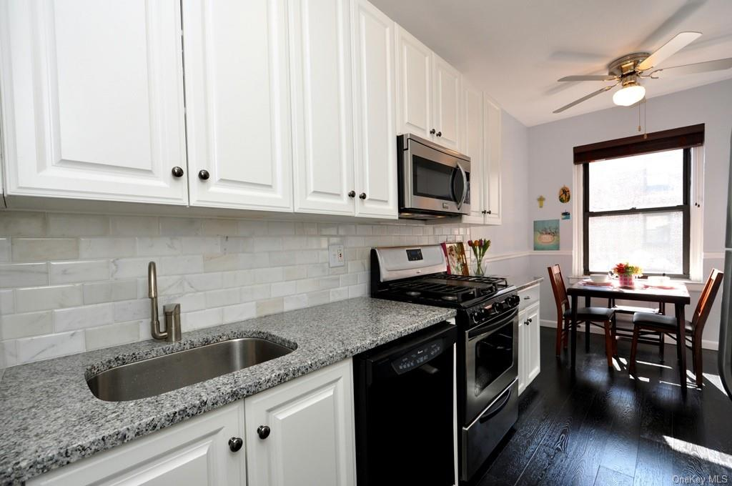 Renovated Eat-in-Kitchen has granite counters and stainless steel appliances.  There is even a widow with sunny Southern exposures.