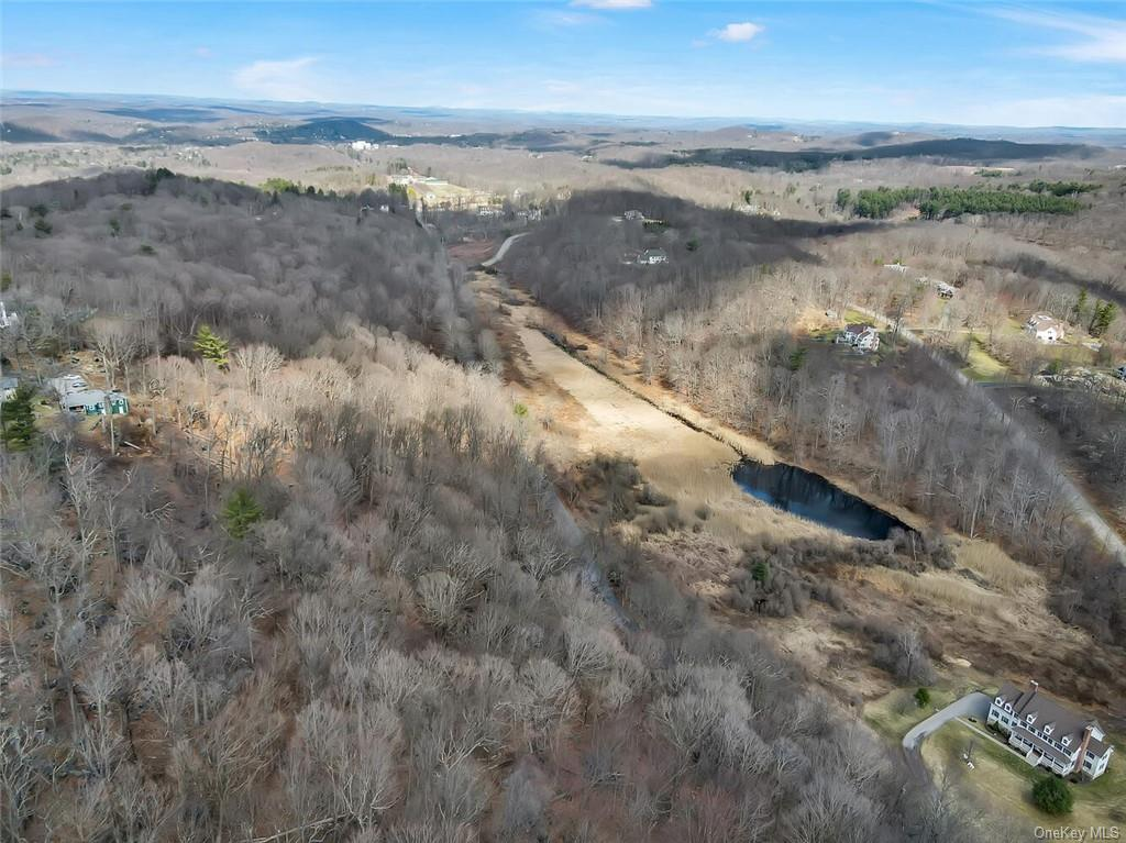 Commanding view over the valley makes this almost 6 acre building lot the place to build your dream home. Quiet Sheather Rd is just minutes to downtown Chappaqua to catch the train, Armonk and Mt Kisco for fine dining plus shopping and services. Bring your architect and your heart's desire.