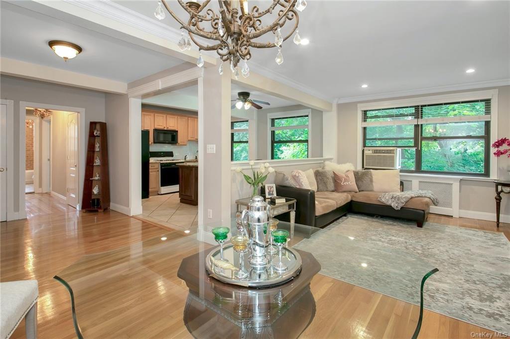Open Floor Plan: new hardwood floors, crown molding & trim, recessed lighting, custom radiator covers, Hunter Douglas wood blinds, new doors & light fixtures throughout apartment