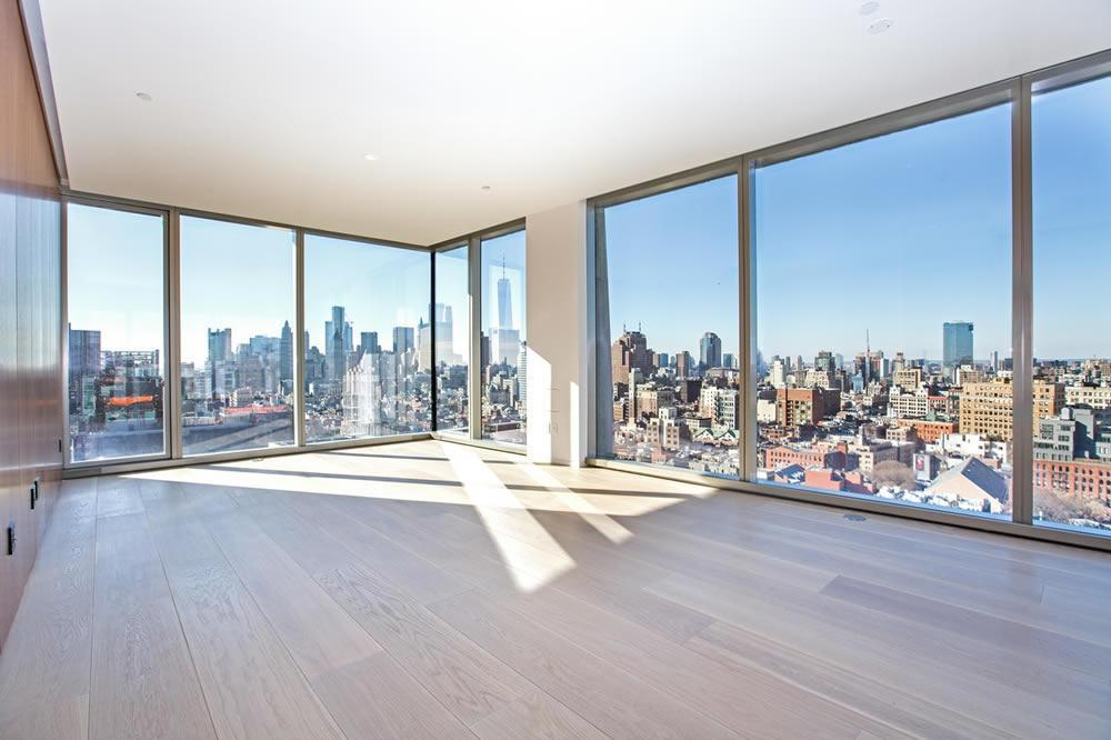 """This is the first resale at 215 Chrystie, an 11-unit condo that exemplifies the highest standards in architectural design. 28W surpasses all expectations in quality finish. This 1,977 square foot has 2 bedrooms, 2.5 bathrooms with spectacular panoramic unobstructed views facing North, South, and West. The exoskeleton, column-free structure, is by the Pritzker-prize winning architects Herzog & de Meuron. Interiors are by iconic minimalist English architect John Pawson. The great room offers a dramatic display: A combined living room and dining room that spans 42 feet surrounded by floor-to-ceiling glass. The kitchen is crafted out of walnut cabinets with Basaltina countertops, island, and backsplash. Fully integrated appliances include a Miele 5-burner flush mounted gas cooktop, Wolf 36"""" oven, Miele 27"""" warming drawer, Miele 24"""" under counter wine refrigerator, Miele 24"""" dishwasher and Miele 24"""" coffee/espresso machine, and a 33"""" sink with stainless steel Vola fixtures. The 591 sq.ft. Master Bedroom Suite has rare unobstructed South views and a dressing area with walk-in closets and custom doors. The Master Bathroom includes a custom designed double vanity with an integrated sink, John Pawson custom designed 6' freestanding concrete tub, and a custom designed shower featuring precast concrete floors and walls, oversized rain shower head, and full height glass shower with breathtaking south views over the city. The unit has a washer and dryer and a large powder room.Building Notes: This 11-unit condo has only 2 apartments per floor. There is a fulltime doorman and unit owners have full use of the hotel amenities in the adjoining hip Public Hotel. 215 Chrystie was designed by Swiss architects Herzog & de Meuron who designed the Tate Modern Museum in London and the Beijing Olympic Bird's Nest stadium among other notable public spaces. Interiors are by minimalist architect John Pawson, who designed London's new Design Museum. Pawson has written books, designed flatware, """