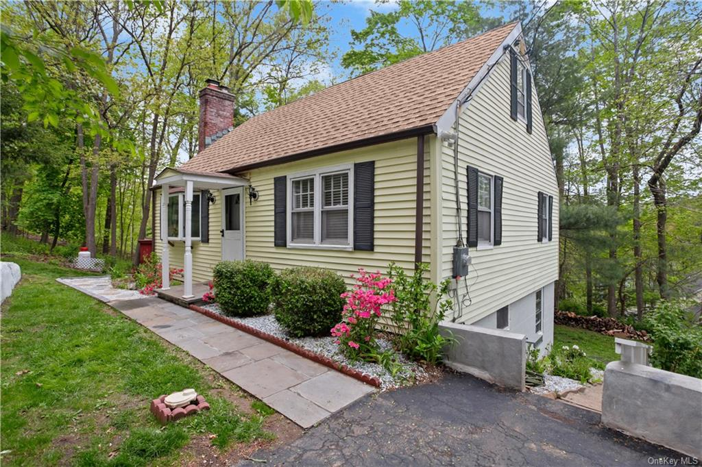 Commuter's Dream, walk to Metro North Purdys Train Station, less than 3 min drive to 684. 2 BDRMS on main floor, lives like 4 bdrm,  2 rooms top level, and 2 rooms with a bathroom in basement above ground. See floor plans in docs. Renovated cape house w/new boiler, new water heater, new hardwood floors, SS appliances, granite countertops in kitchen, floor to ceiling tilework in bathrooms. All new interior doors. Freshly painted. In-law apt. w/separate slider entrance. Flat fenced yard. Beautiful private deck immerses you in nature. LR w/Fireplace & bay window.  Lake Purdys beach and clubhouse membership available to residents. Five min ride to shopping, DeCicco's Market, CVS. Starbucks is coming soon to Somers. Plenty of shopping & restaurants close by. Low taxes. Private & serene setting & quiet street. Flower & vegetable garden. Seasonal water views. Shed included.  New stone paver walk-way. Water purification system installed recently. Laundry Room w/washer & dryer. Small work space near mechanical area. 3 blocks walk to train. Please provide covid disclosure and pre approval for showing.