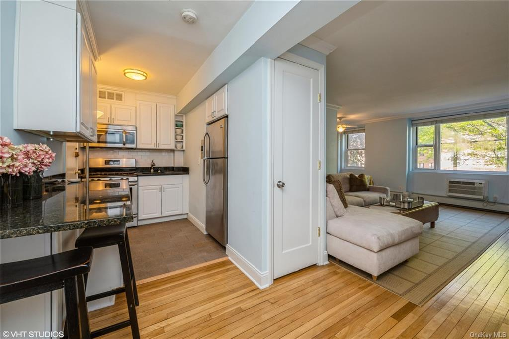 Fully renovated apartment seen from entry foyer.