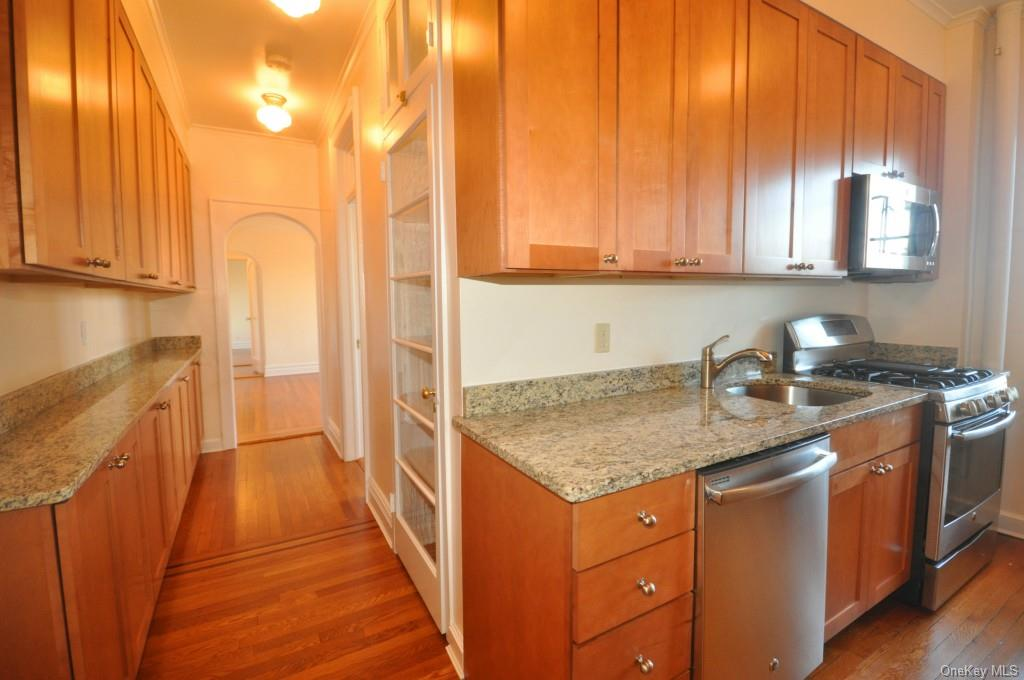 New Kitchen with Granite Counters and stainless steel appliances including a dishwasher, range refrigerator and microwave. There is also a large butler pantry that leads to the formal dining room.