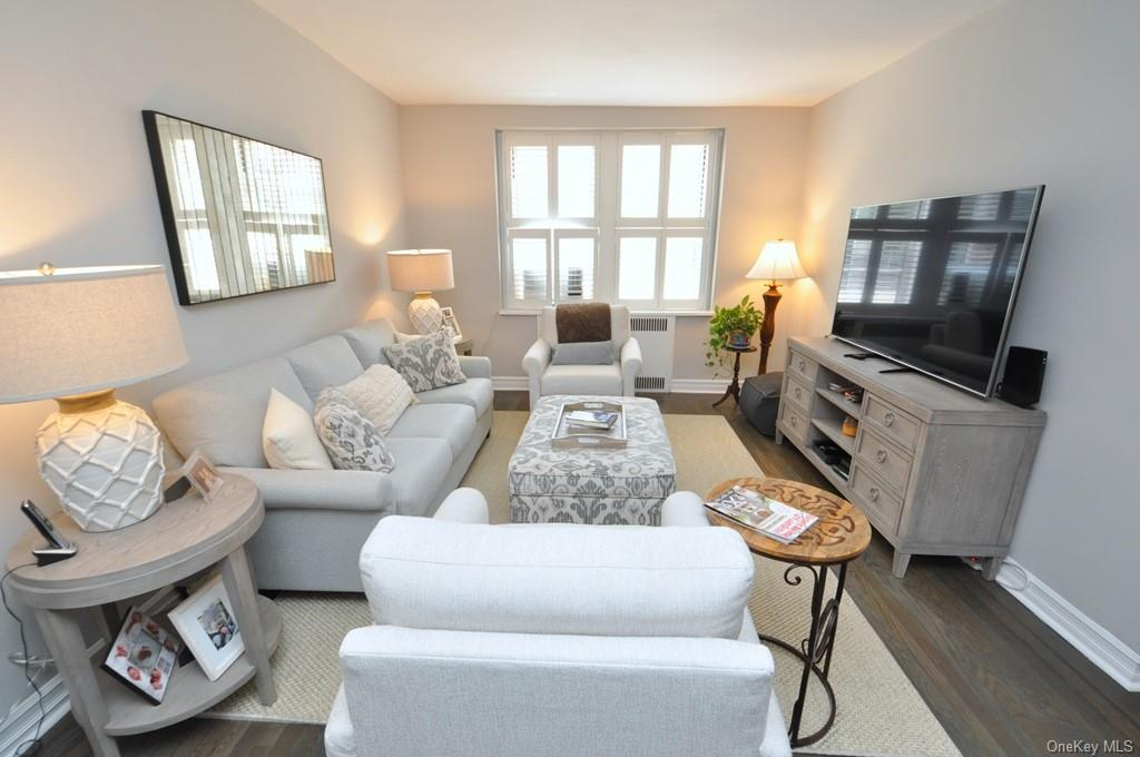 Large Sunny Living Room has Southern Exposures and new hardwood floors.  The room is 20'-0