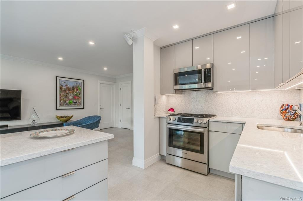 Open Concept renovated kitchen with Quartz counters and back splash
