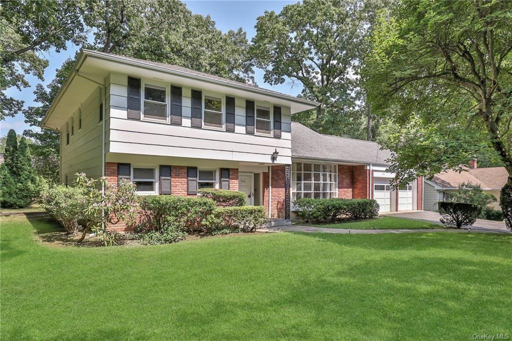 A diamond in the rough in top-rated Scarsdale School District. Perfect .35 acres of luxurious backyard paradise for families with children and pets to run and play. The stunning and unique open floor layout offers three levels. No steps...enter into a graceful flagstone foyer and brilliant sunshine beams through the beautifully designed bow windows.  A must-have... in high demand, an oversized master bedroom and large full bathroom which flows into an oversized family room. Open family room sliders to a huge patio to entertain family and friends. The second level has an expansive living room, eat-in kitchen, and formal dining room. The eat-in kitchen opens to the patio to make entertaining a breeze. The second level offers a second master bedroom en- suite and two oversized bedrooms; one used as an office now and a full hall bathroom. Tons of closet space and a partially finished attic, could be third floor as it is the entire footprint of the house. This captivating, warm, and welcoming home is on the market for the first time in 52 years. This gracious home offers a new family the opportunity to recreate family milestones, memories and design it to be your own sanctuary. Only minutes to Houses of Worship, medical centers, Westchester Mall, downtown White Plains restaurants and shops, nature preserves, Crossway Ball Fields, Scarsdale Community Pool, horseback riding stables, and The Golden Horseshoe Shopping Center. A commuter's dream, only 35 minutes to NYC. House being sold as is.