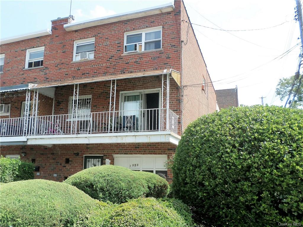 Semi-detached, solid brick, corner property, 2-family home with attached garage plus one car driveway. Located in the northeast section of the Bronx. Walk-in level, full basement, with direct access to backyard. Close to bus, train and all area amenities.
