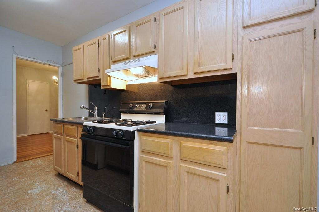Updated Eat-in-Kitchen has plenty of cabinets and counter space.  There is even a window for ventilation.
