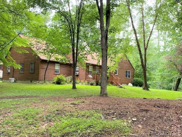 If seclusion is what you desire, look no further! This cedar sided, expansive ranch sits up a long driveway to ensure your privacy.  Set on just under 4 acres which borders hundreds of acres of Pinchot Estate property. 3 brs, 2.5 baths, large gourmet kitchen w/6 burner garland stove, tile & wood floors throughout.  Custom made wood trim, large deck for entertaining.  Great location. Just 2 minutes from charming Victorian Village of Milford, PA. Home needs a few finishing touches, few moldings, ceiling fan installed, etc. Materials will stay.  A small barn, fenced organic veggie garden to grow your own and a chicken coop.