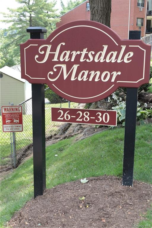 CONTRACTS OUT & SIGNED.  NO FURTHER SHOWINGS AS PER CLIENT!!!! This is it!!!  Welcome to the highly sought-after Hartsdale Manor.  Private street, yet close to shopping and buses and neighboring City of White Plains.  Large, 1,200 s.f., immaculate 2-bedroom unit with large open-concept living room and dining area.  Master bedroom big enough for a California King size bed.  Updated tiled kitchen and tiled bathroom with newer Bath-Fitter tub insert.  Hardwood laminate flooring, pull-down attic for extra storage, private large terrace, unassigned parking (in parking lot or street parking), pool, laundry rooms and pet-friendly too (dogs - restricted weight - 40 lbs. for one dog or up to two dogs equaling 40 lbs.; cats okay too; check with management for dog breed types).  You can also use an electric grill on the terrace for your intimate cook-outs.  A co-op with the feel of a house.
