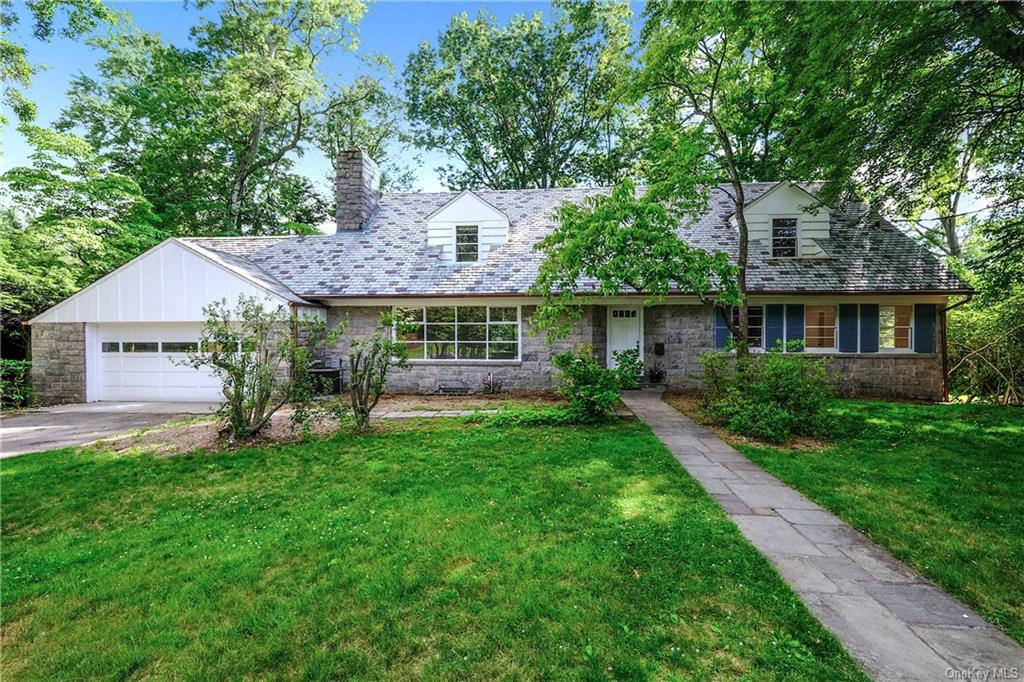 Spacious 5 bedroom Colonial with 3 full & 2 half baths nestled in the heart of Fox Meadow, within easy walk of NYC train. Beautiful & serene .58 acre property has the original tennis court & a huge rear yard which presents a myriad of recreational & entertaining possibilities. Interior features include a spacious & sun-filled living room with wood-burning fireplace, formal dining room with access to an enclosed porch and views of backyard, large eat-in kitchen with separate breakfast nook & access to outdoor bluestone patio. A highlight of the first level is the large Family Room with stunning teak parquet flooring, custom built-in bar & slider doors showcasing the rear property. The house has a first-floor guest room with private bath, 4 bedrooms (incl Master BR suite) are upstairs & the walk-out lower level has a large, open 1044 SF recreation room offering great potential for home gym, game rooms etc. Super convenient location, within easy walk of schools, village, shops, & dining!