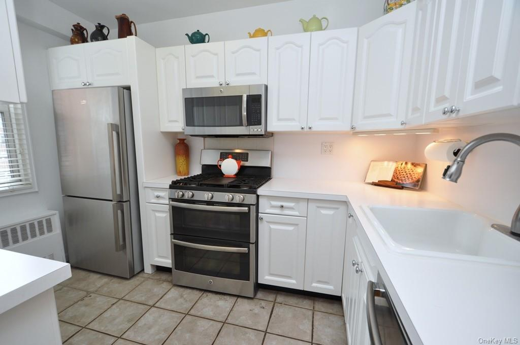 Updated kitchen has stainless steel appliances including a dishwasher, microwave, double oven and refrigerator.