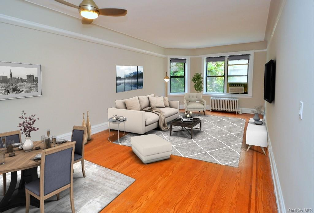 Large Living Room has new hardwood floors, molding and views of Garth Woods.  The room is 23'-10