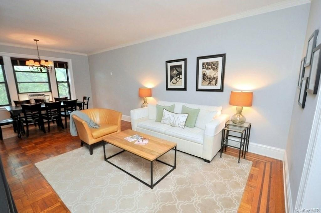 Living room opens to the dining area and has parquet floors.  The living space is 23'-0