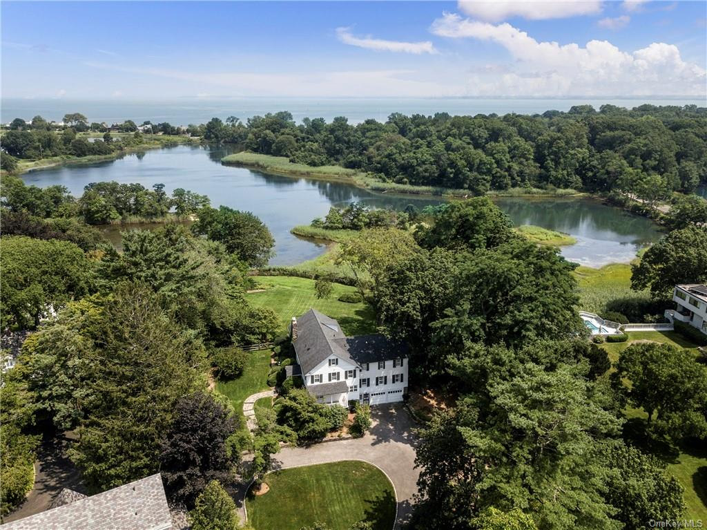 It is all about the views and the privacy! This charming colonial is a hidden treasure tucked away at the end of a long driveway, and is one of only three houses directly on Kirby Mill Pond South. Kayak or paddleboard to your own island and peninsula in this one of a kind tranquil setting. The house features three wood burning fireplaces, and traditional appointments make it rich in detail. The elevation of the house on the water just enhances the views even further. This parcel will be sold together with an additional waterfront .79 acre peninsula parcel of non buildable, vacant land known as 176 Kirby Lane (additional taxes $1533/yr) that is not contiguous to this property. This ideal setting is only five minutes to town, train and blue ribbon schools, and 45 minutes to Midtown Manhattan.