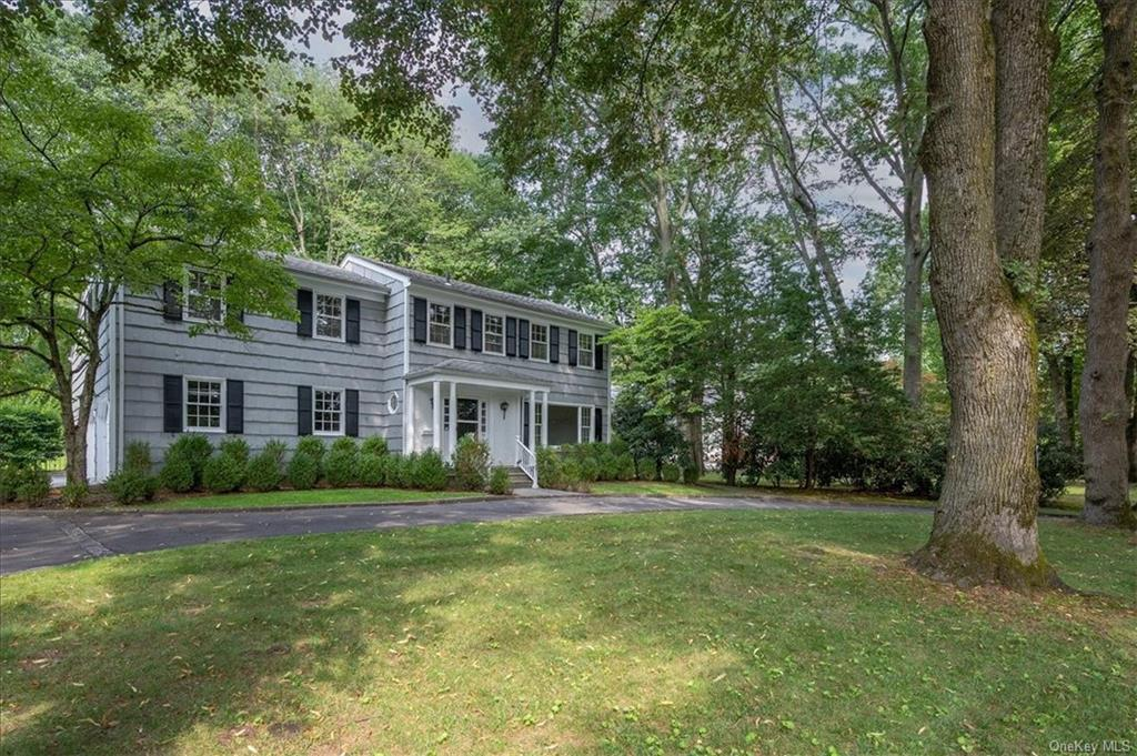 RARE OPPORTUNITY OWNERS JUST RENOVATED AND ARE RELOCATING! Modern Colonial ideally located on a quiet sought-after location in the heart of Heathcote. Enjoy a private setting accessed via a stately circular drive. This house offers nearly half an acre of flat parklike land with ample room for a pool and recreation. Walking distance to Heathcote Elementary School, Scarsdale Pool, parks, equestrian center, shops, and tennis courts. Enjoy spacious, light-filled formal and informal spaces featuring freshly painted interior and exterior, stunning newly finished hardwood floors, large windows and skylights. 5 bright large bedrooms with multiple windows & large closets, 4 full baths plus a formal powder room, modern all-white eat-in Kitchen with separate breakfast area, large family room with fireplace and glass doors, oversized deck for stylish outdoor entertaining, 1st floor bedroom/office with full bath, incredible living room with cathedral ceiling and skylights, bright walkout basement.