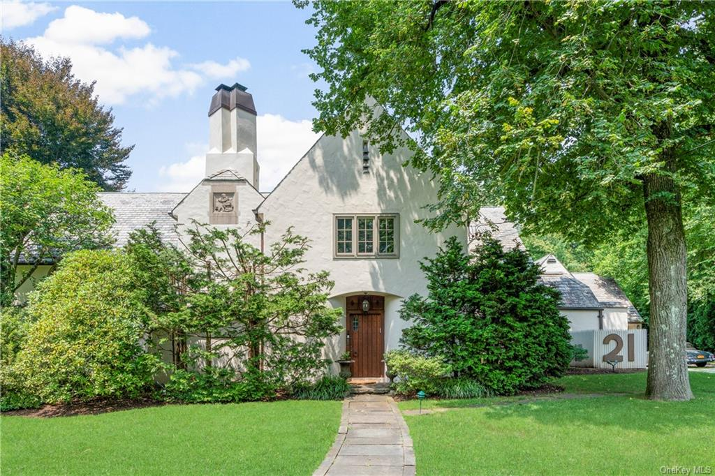 Where Modern Art meets History...welcome to this magnificent Tudor steps away from schools, Scarsdale Village w/ train, shops & restaurants. This artisan restored home was meticulously redesigned to the highest modern standards in European style and high eco-friendly-efficiency. On the 1st floor enjoy the Great Room as Formal Living and/or Family Room w/ a completely restored cathedral ceiling, cozy fire place & grand oversized windows, the Dining Room and the Kitchen are built to a modern open flow perfect for entertainment and an Office overlooking the garden w/ Patio, salt water Pool & Basket Ball court. The bright Mud Room leads to the heated 2 car Garage w/ EV charger & to a Guest House w/ its own Kitchenette, Powder Room, 2 Bedrooms, Full Bath & Living Room. The 2nd floor has a Master Suite w/ Designer Bath, European built-in Closets & 2 spacious Bedrooms w/ J&J Bath. The lower level offers a great Full Bath w/ pool access, a Media Room, Laundry & ample Storage. Uniquely special!