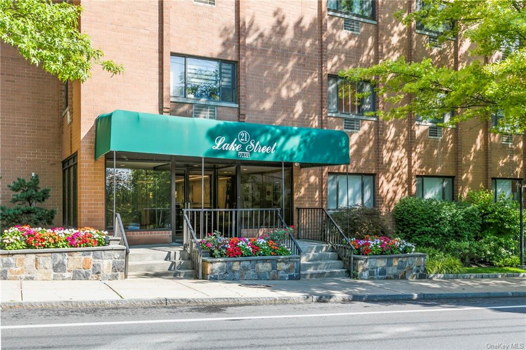 Must see----Sought after Condo in Concierge building in the heart of White Plains. Spacious and sun-lit corner unit features balcony with great views. Living room has wet bar and built-in Cabinet.  The master bedoom is great size and the office/den/2nd bedroom has a private balcony. The heated parking space (#5) is assigned to the unit.  (Parking Level AB)  Kitchen has pass-thru with door to laundry/utility room, pergo flooring throughout. Updates: Furnace (4-5 years), new medicine cabinet, outlets several years ago, unit is being entirely painted next few days.   Convenient and centrally located.....Close to City Center, Westchester Mall, Metro North RR, Shopping, Serene park, dining, night life, movie theaters, major highways.    2nd ongoing assessment $20.67/mo. for 5 years started January 2020.  Assessment of $169.05 (capital improvements)   ends January 2023.