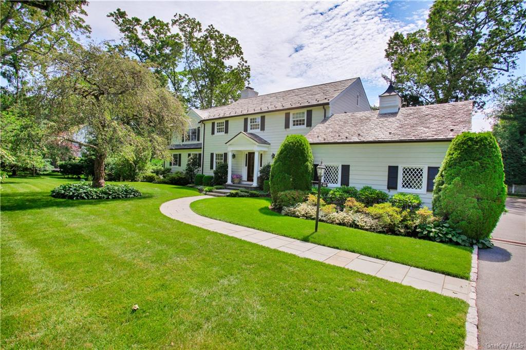 This renovated, custom designed classic 4 bedroom, 3.5 bath Colonial is located on a beautiful tree lined street, flanked by two prestigious golf courses and situated on .5 acre, of professionally manicured grounds with glorious perennials.  Exquisitely designed principal rooms include a gracious living room with a bay window, wood burning fireplace, formal dining room, library/office and gourmet kitchen with top-of-the-line appliances, a center island, granite countertops and breakfast area.  The fabulous addition is the gorgeous oversized, family room with powder room, wet bar, wood burning fireplace and sliding glass doors which combines seamlessly with the expansive patio to the heated gunite pool with spa, built-in gas grill and fridge.     Ample living quarters include the primary bedroom suite with tray ceiling, walk-in closets and sumptuous en-suite master bath with a radiant heated floor, double vanities, jacuzzi tub and separate steam shower.  Three additional bedrooms and a renovated full bath complete the second level.      The walk-out basement has a bathroom, gym, laundry, and two play/entertainment areas.  Additional features are the full-house generator,  two-car attached garage, storage shed, landscape lighting, slate roof and copper gutters.  Hardwood floors, recessed lighting, central a/c, built-in speakers/surround sound.
