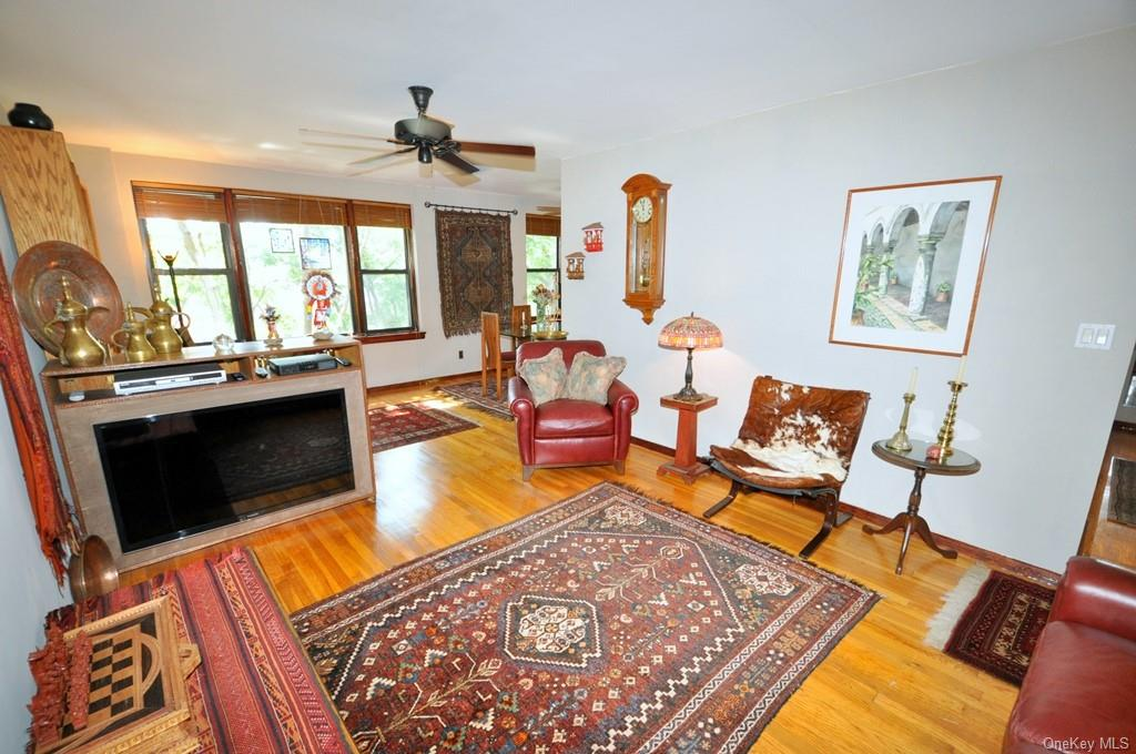 The large living room can accommodate an entertainment area and reading area and has refinished hardwood floors.