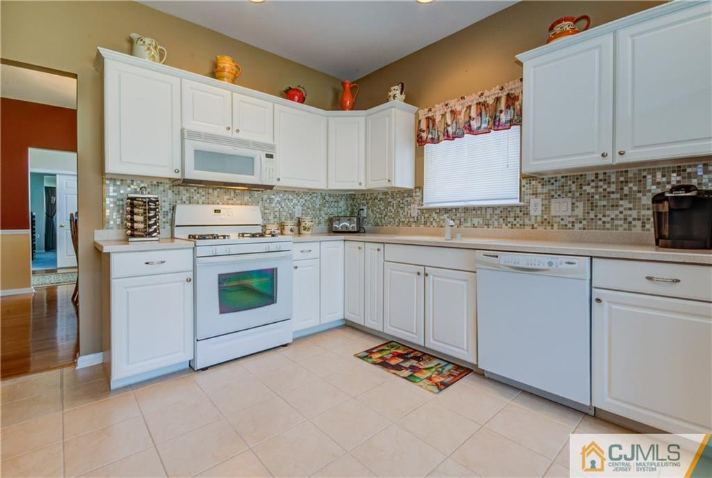 Stunningly Spacious, Elegantly Updated,Bright & Beautiful Ranch! Highly Desired Byron Model Ranch in Great Location w/rear Private Wooded Park Land located in Prestigious Renaissance Gated CommunIty!