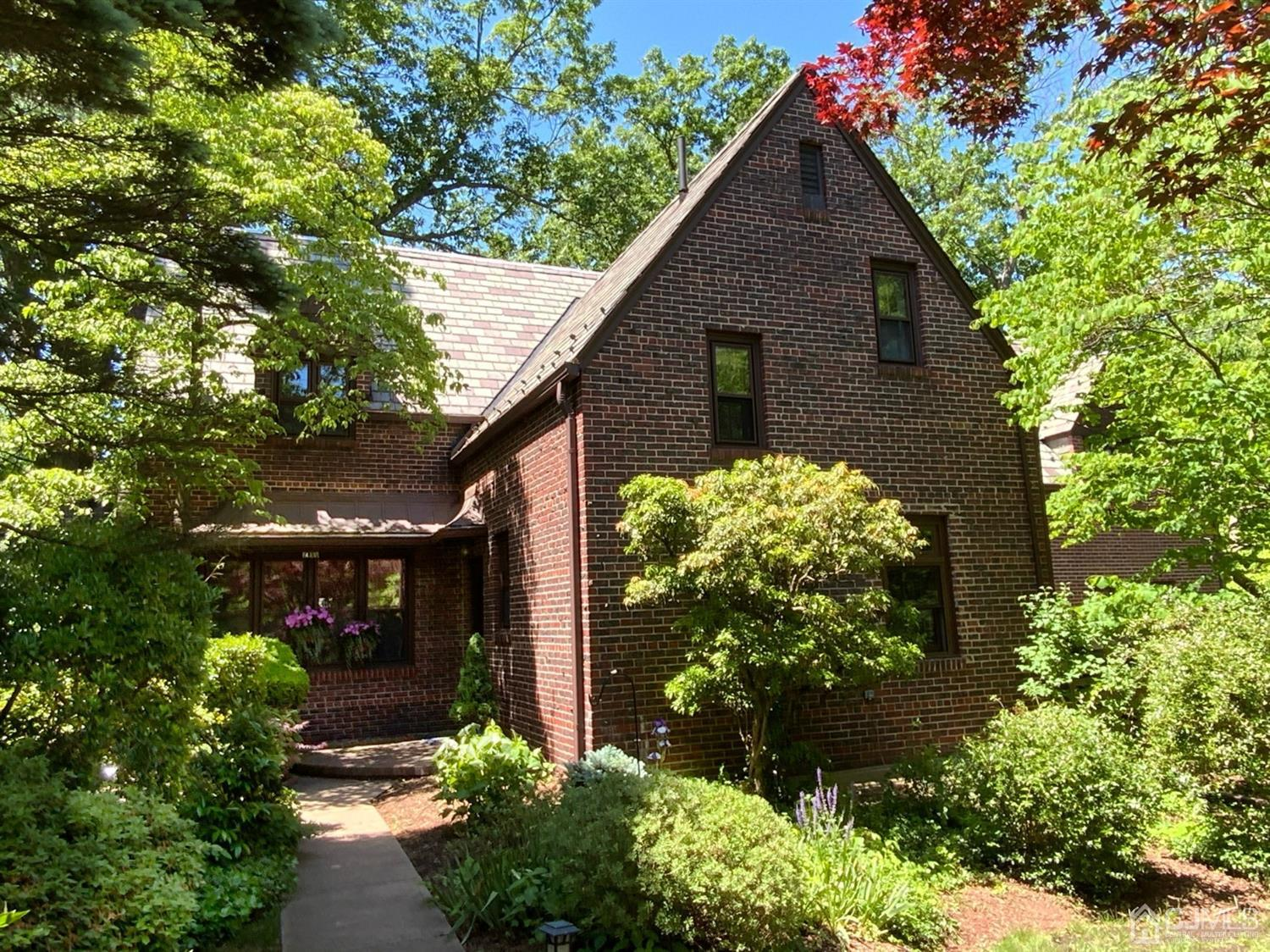 Beautiful, spacious, brick home with two decks and three tiered patios for outdoor entertaining.