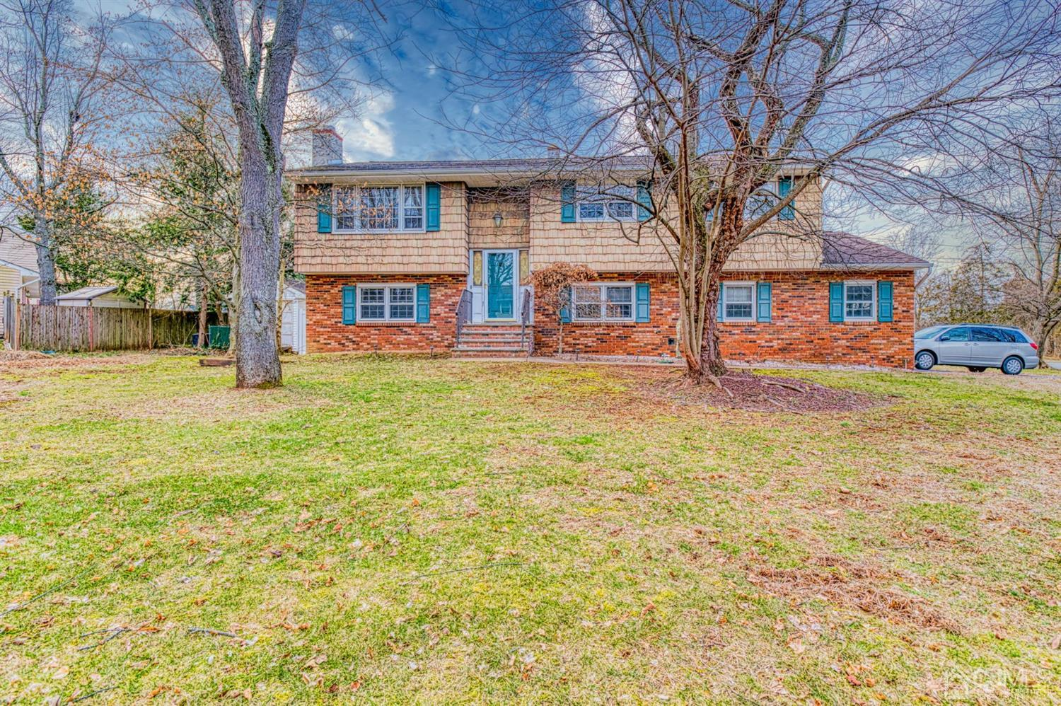 Great Bi-Level in Private Rutgers Location with Huge Deck Overlooking Large Fenced Yard and Built-in Pool!!