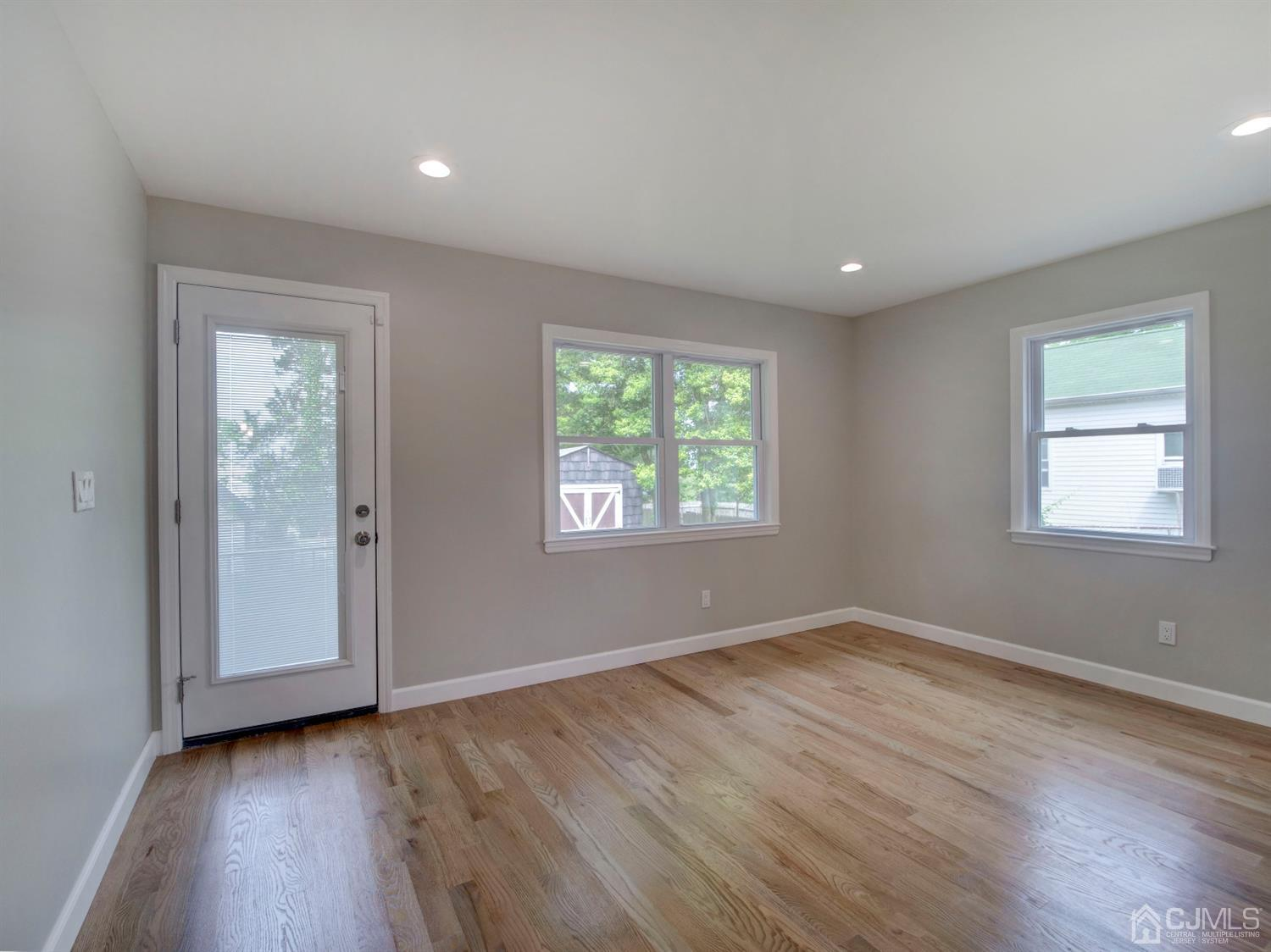 Bonus room off the kitchen with access to back large. Can be used a separate kitchen dining area or play/game room.