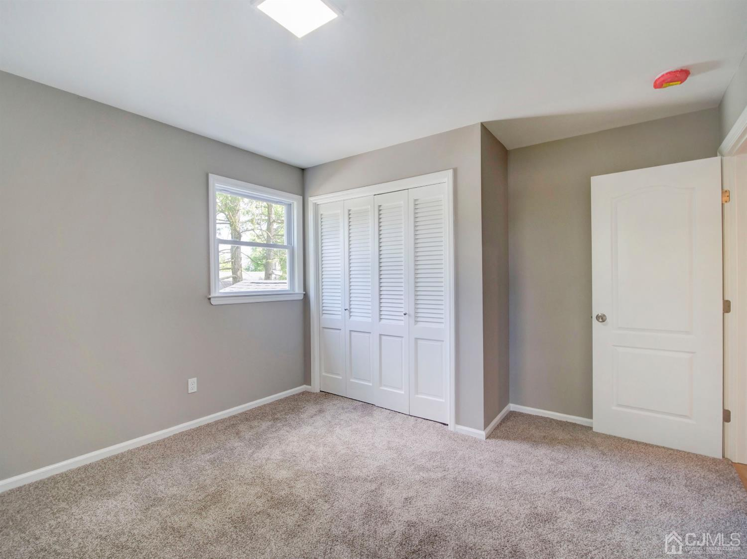 3rd bedroom of 4 upstairs with double closet